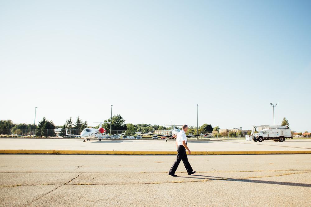 pilot walking runway at Kalamazoo International Airport