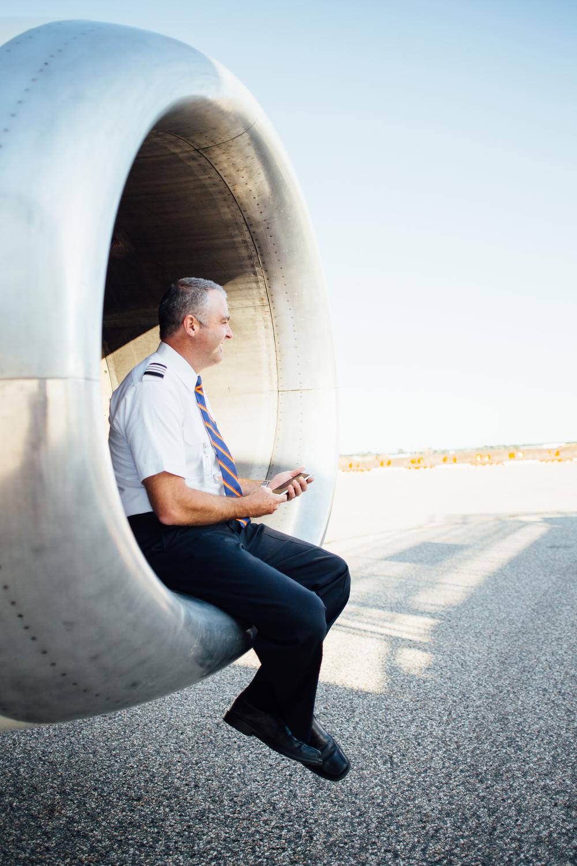pilot sits by plane propellers at Kalamazoo/Battle Creek International Airport
