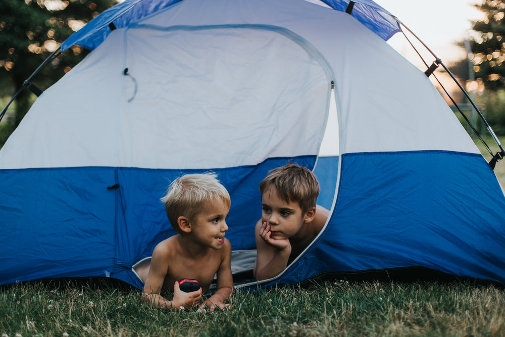 two young boys in tent