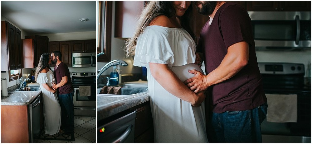 husband and wife embracing in kitchen