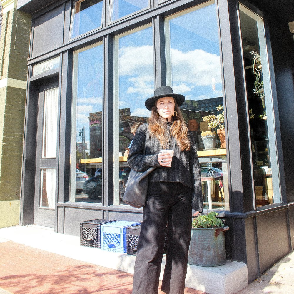 Wearing Tio y Tia Gamber Hat, Ayr Sweater (similar), Ozma of California Mock Neck Tank, Jesse Kamm Sailor Pants, Kristiina Taylor Leather Tote Bag, and Chanel Classic Ballet Flats.