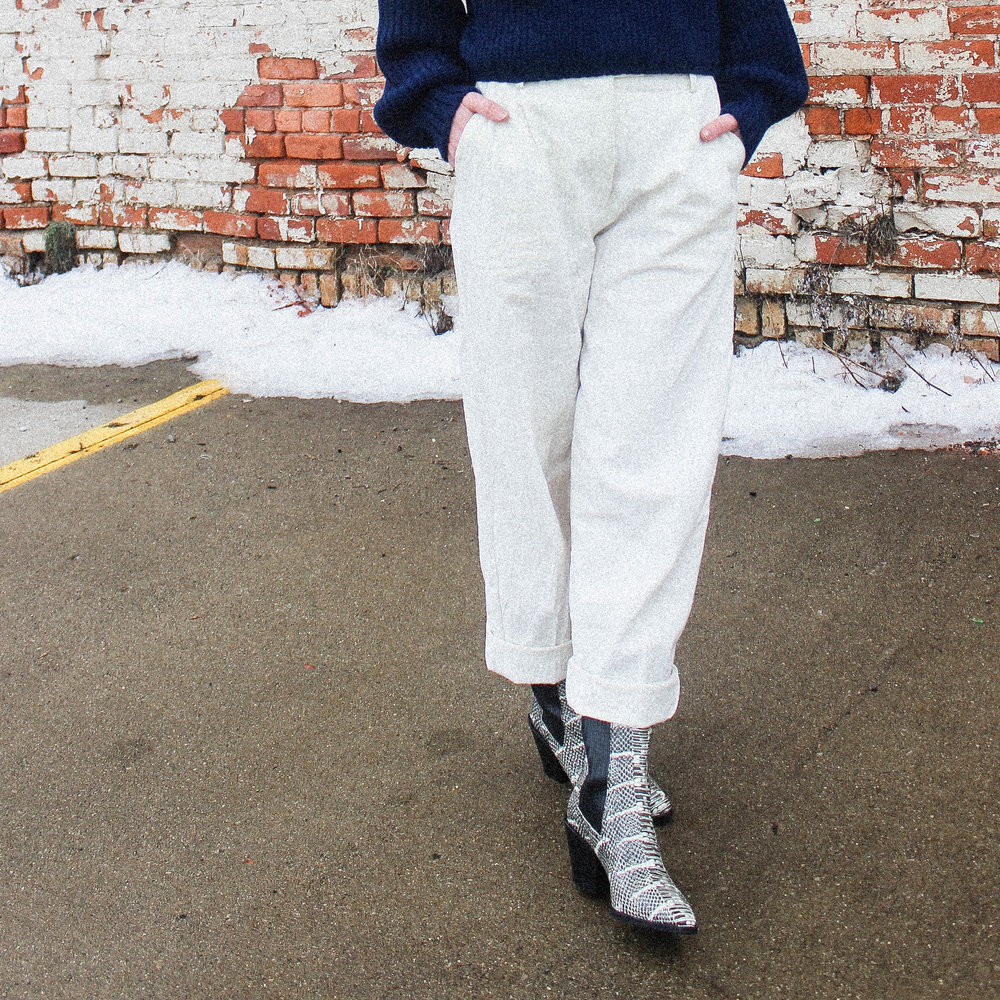 FIRST RITE CROP TURTLENECK IN LAPIS, THE WYLDE LUCETTE PANT, AND AEYDE ARI BOOTS.