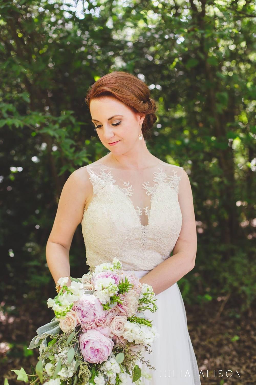 classic, cascading bridal bouquet blush and cream peonies roses dahlias wildwood inn denton wedding photo by Julia Alison Photography