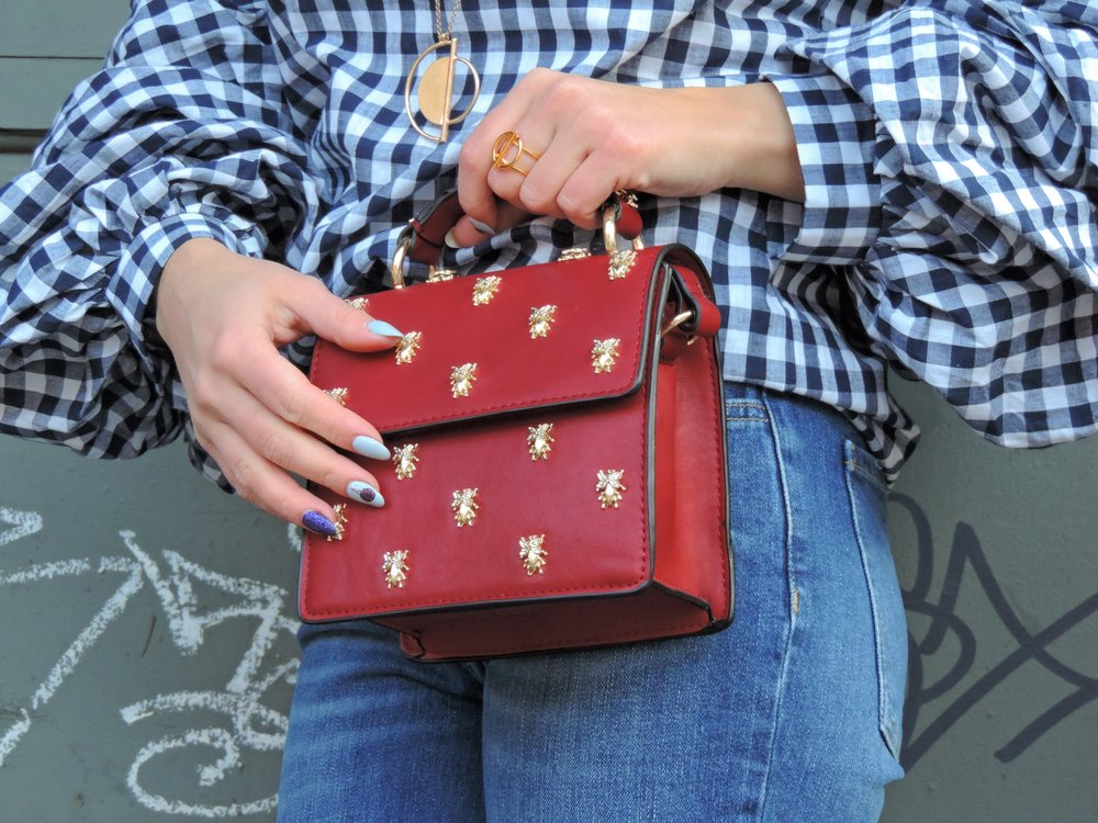 bug print cross-body bag