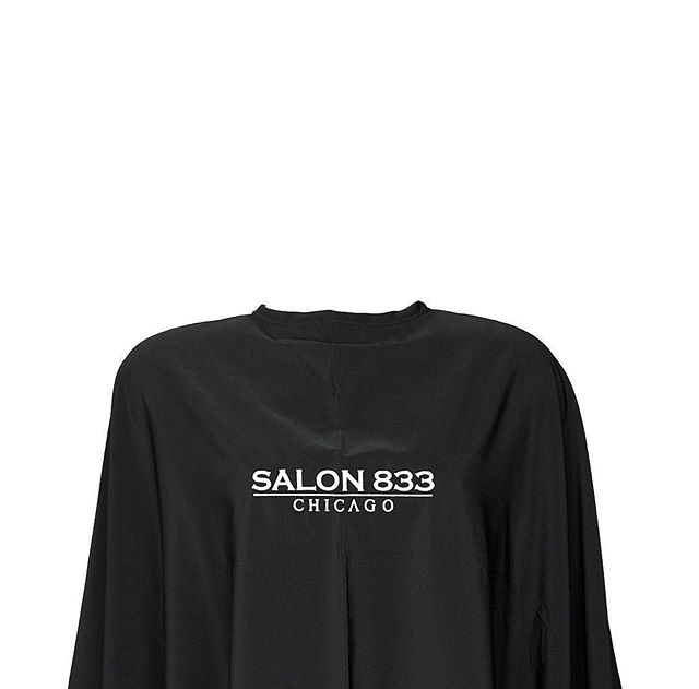 Microfiber Cutting Capes we produced and embroidered for the talented girls @salon833chicago. - Light. Silky. Soft; accompanied by our most popular and timeless combo; White Thread and Black Cape. - Visit our website for Cutting Capes and Embroidery services - link in bio!