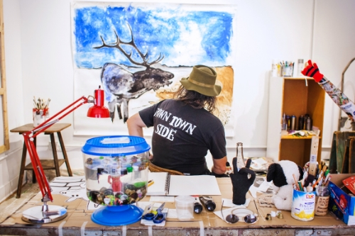 Wild Life in his studio preparing for his show at These Days (image via Cartwheel Art)