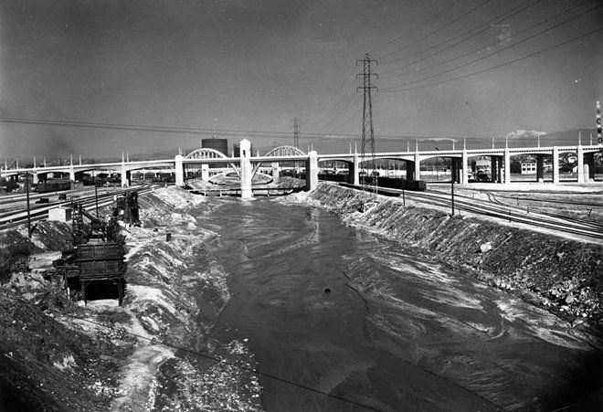The Los Angeles River in 1938 looking from The Flats towards the 6th Street Bridge amidst paving construction. (photo via LA Public Library archive)