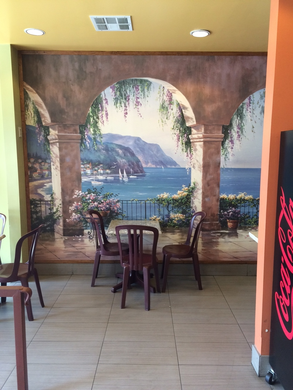 Classically-inspired frescoes line the walls of Med Grill. Photo by Dan Johnson.