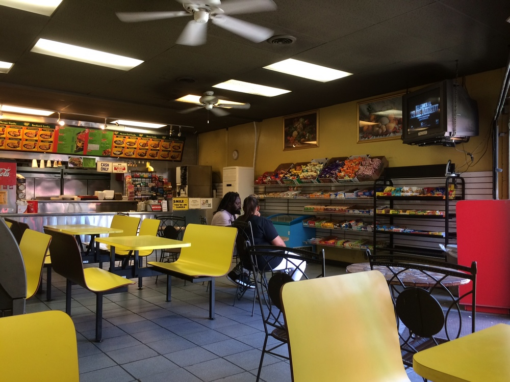 The interior of Richie's, where patrons discuss everything from local beatings to bail bond rates to beef patty quality. Photo by Dan Johnson.