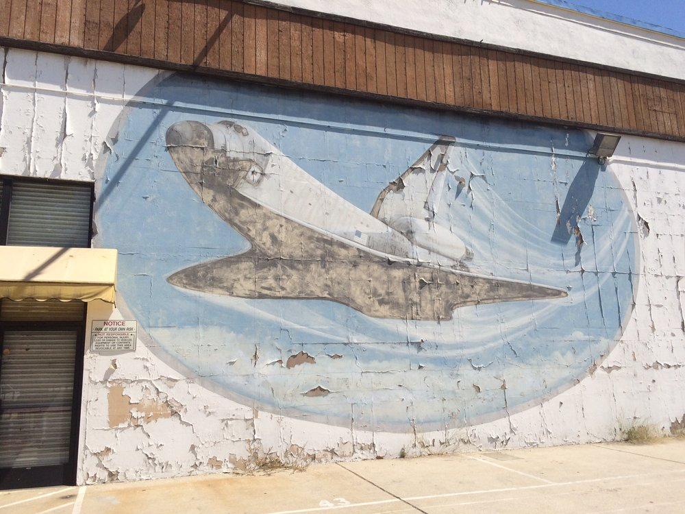 This mural tribute to the ingenuity and technological might of mankind featuring the Space Shuttle Columbia was likely painted prior to the spacecraft's fiery disintegration in 2003. Photo by Dan Johnson.