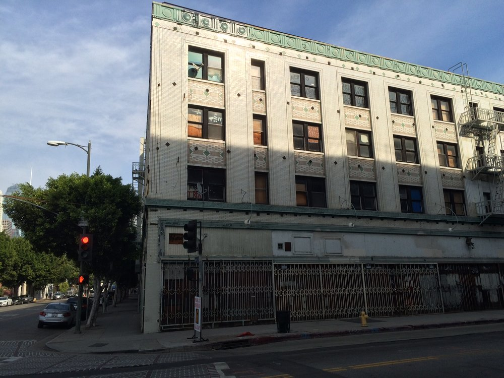 The Morrison Hotel at 12th St and Hope St is now boarded up and abandoned even though it was immortalized by Henry Diltz's photograph of The Doors at the hotel for the cover of their album Morrison Hotel. Photo by Dan Johnson.