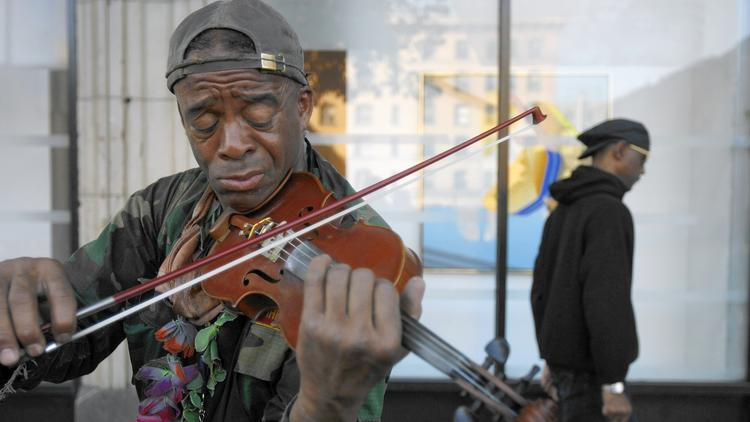 Famed formerly homeless violinist Nathaniel Ayers, who served as the main inspiration for Gupta's organization Street Symphony, returned to join the Messiah performance last year.  (photo via Rick Loomis / Los Angeles Times)