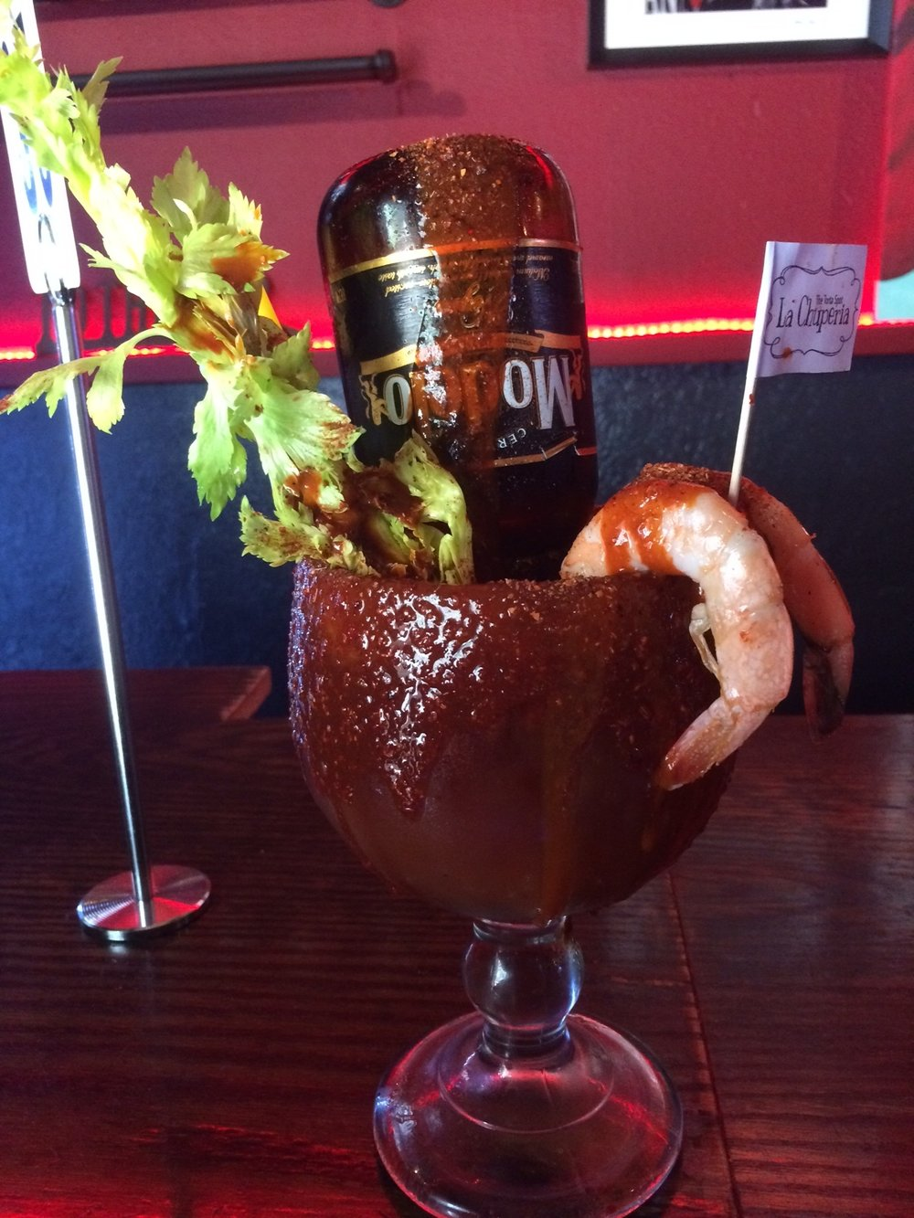 The micheladas at La Chuperia are enormous and powerful – one could very well last you an entire quarter of whatever sports game you choose. Photo by Dan Johnson.