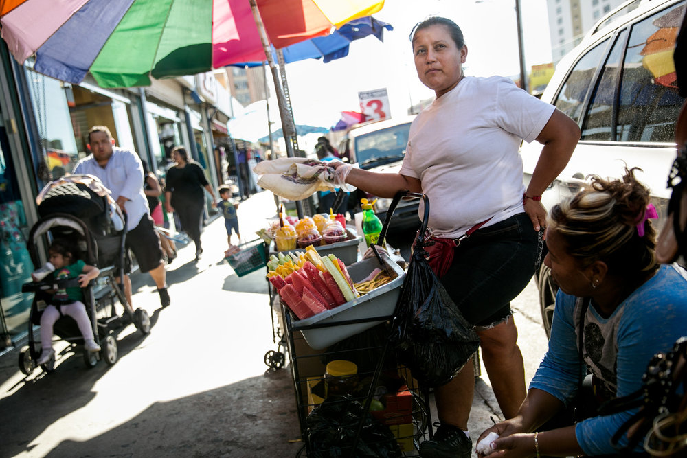 Maria Franco has been selling fruit in Downtown's Fashion District for the past 12 years. She will no longer risk misdemeanor charges by conducting business on the sidewalk. (Image via LA Times).