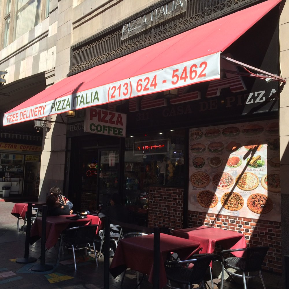 Pizza Italia (Free Delivery!!!) could be Corleone's most bitter rival. Or maybe they are best friends. Either way, stop trying to make Los Angeles New York. Photo by Dan Johnson.