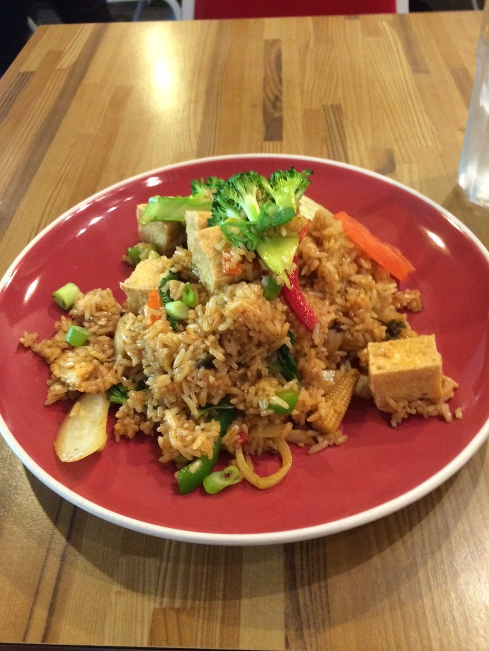 The absolutely delicious tofu spicy fried rice just didn't do it for the author, who, like an addict with a high tolerance, needs an unhealthy amount of food in his stomach just to feel normal. Photo by Dan Johnson.