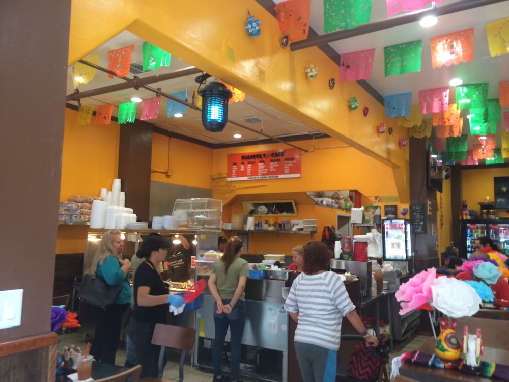 Perhaps the spacious interior and multi-colored flags at Juanita's Cafe are what justify the higher price point than her across-the-street sister Tacos Acapulco. Photo by Dan Johnson.