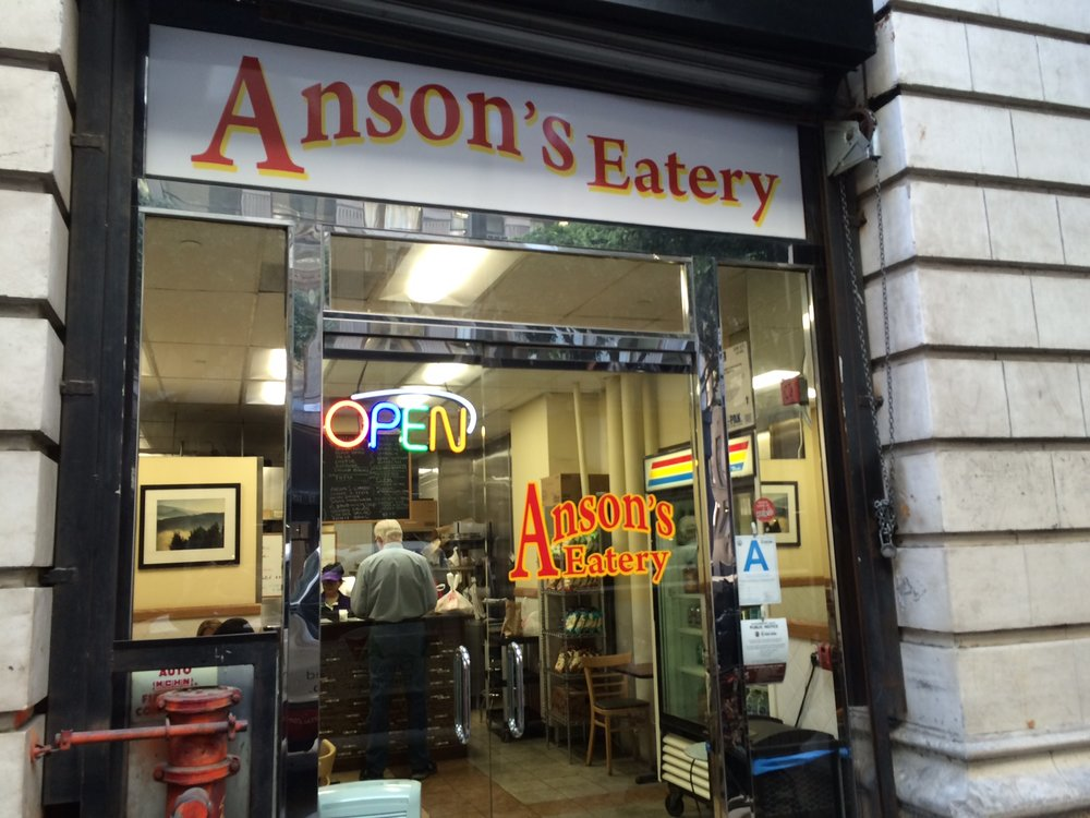 "The multicolored ""Open"" sign is the most exciting thing at Anson's Eatery...and that's ok. Photo by Dan Johnson."