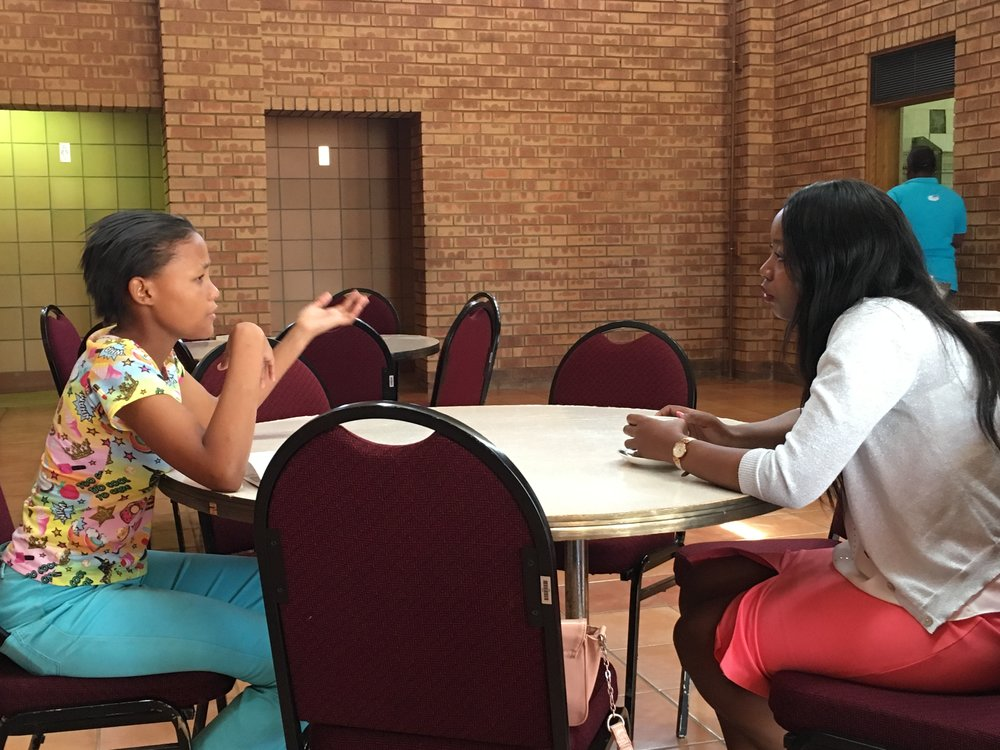 IAWA ambassador speaking with career symposium presenter