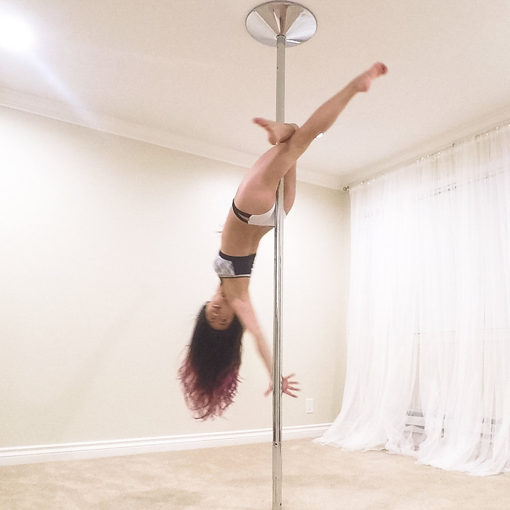 Step 7  As you fall back, twist your upper body so you can grab the pole.