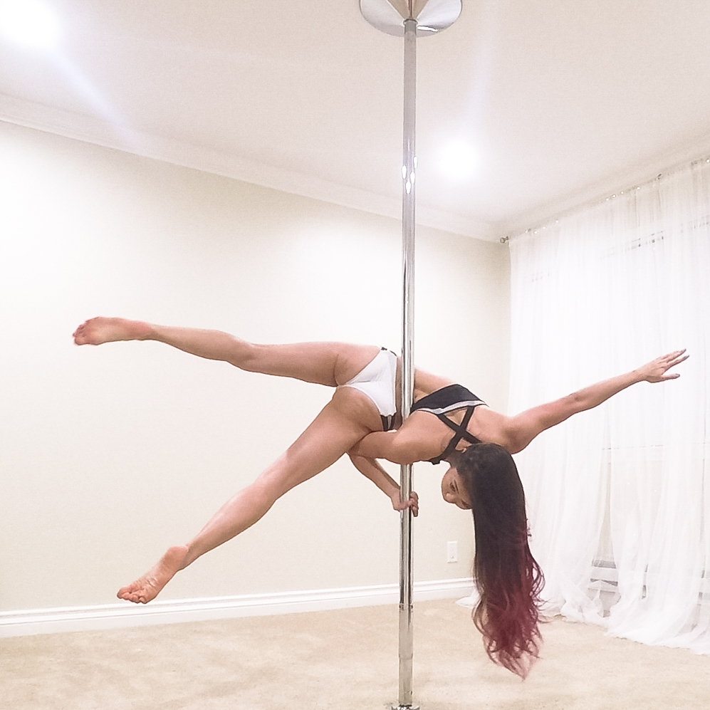 Step 4  Once in the Janeiro, actively arch your back to stay balanced in the pose. Your back should be touching the pole.