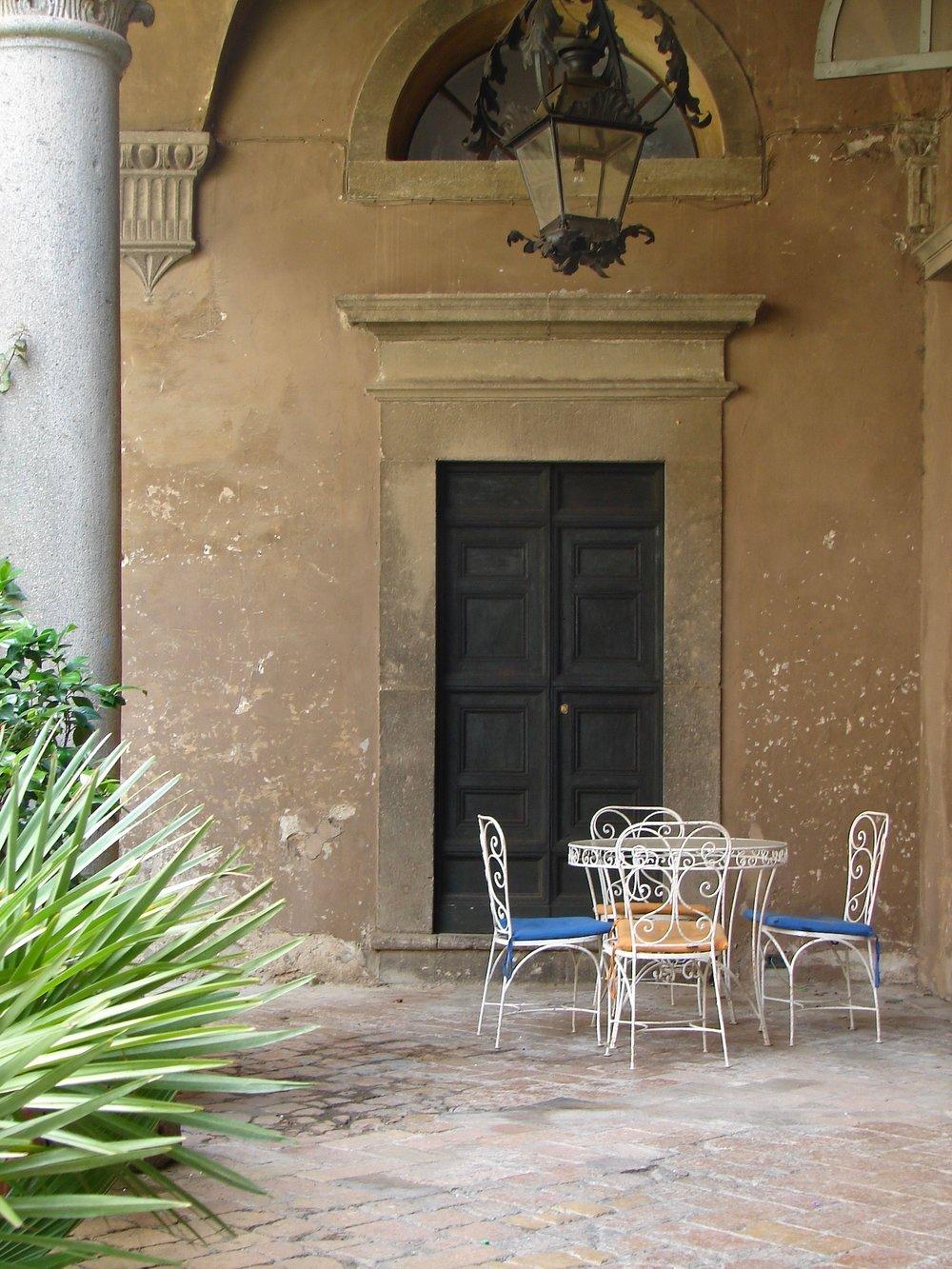 Little outdoor table in front of door to chapel