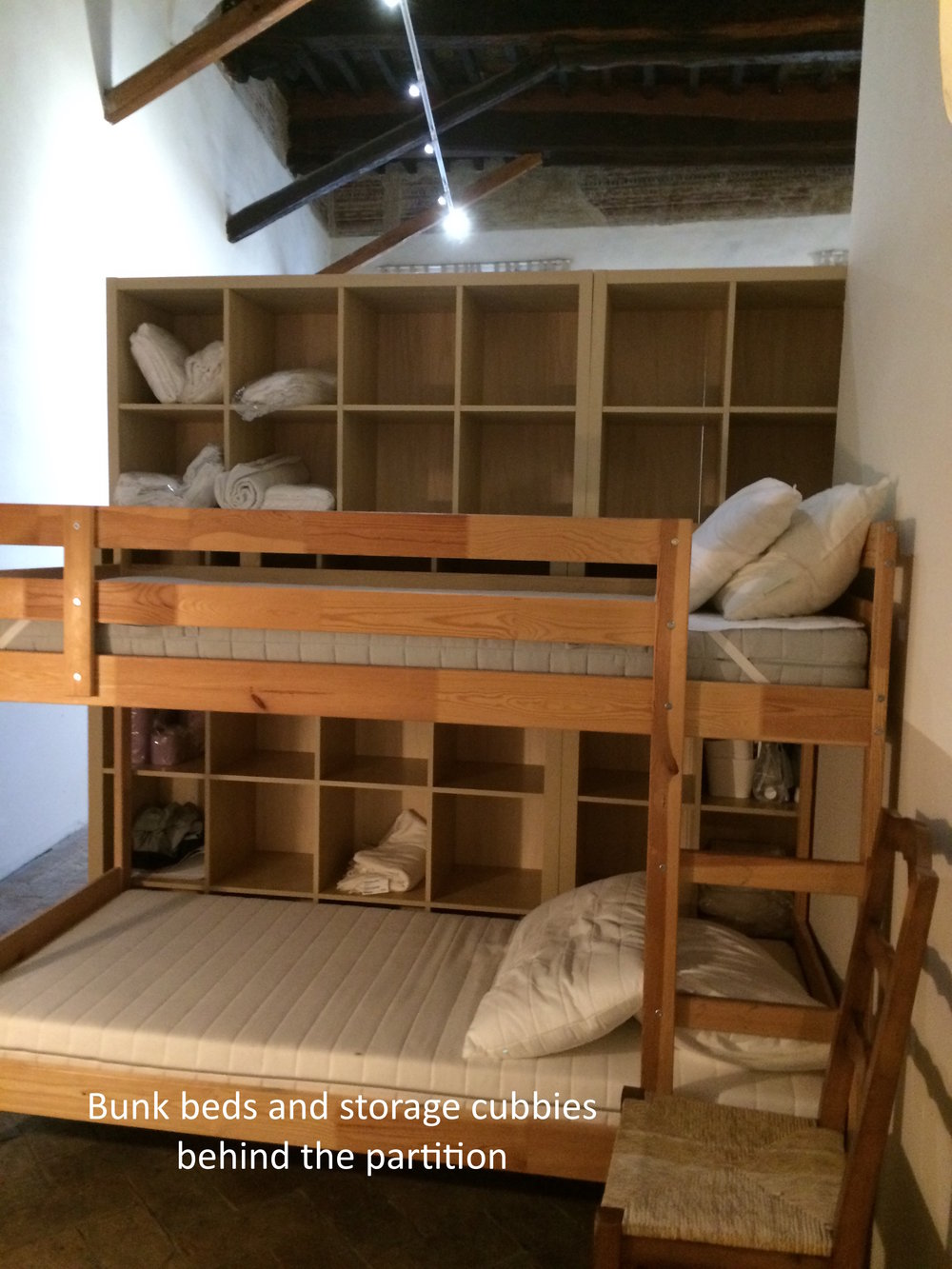 #15 Bunk beds behind partition.JPG