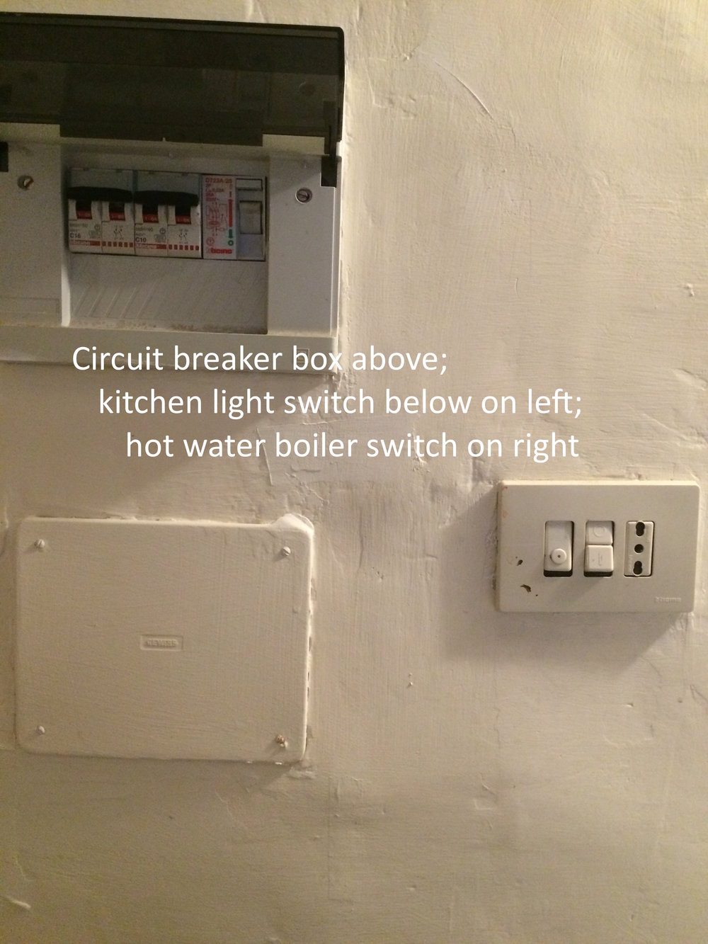 #30 Light switches and circuit breaker box above stove.JPG