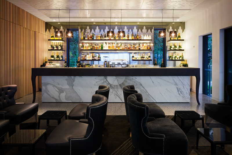 Cusom designed radial motif for lasercut marble bar front at The Sergeant's Mess Chowder Bay
