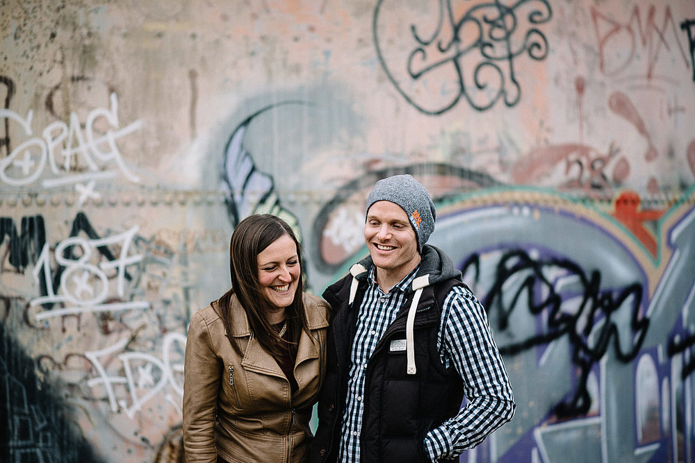engagement shoot in front of graffiti