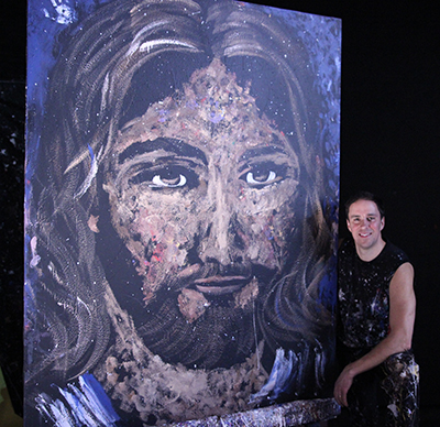 Speed-painter and inspirational speaker Rob Surette with his painting of Jesus Christ, completed Live at Williams in less than 10 minutes.