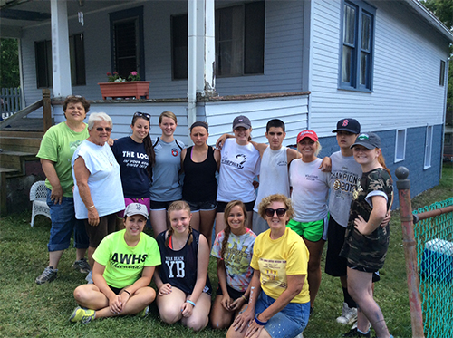 Archbishop Williams students partnered with The Sisters of Charity of Nazareth to complete a service project in Barton, Ohio. Sitting from left: Anna Kiley, Samantha Dore, Victoria Putnam, Ms. O'Brien. Standing from left: Sr. Luke Boiarski, Sr. Angela Hicks, Jenna Troderman, Lillian Delaney, Lauren Carter, Caroline Donnelly, Brendan Flynn, Gen Grasso, John Flynn and Erin Keating. PHOTO: Archbishop Williams Campus Ministry