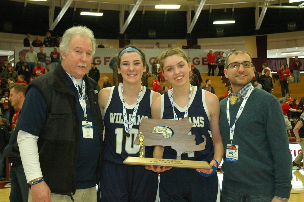 AWHS President Dennis Duggan, captains Mollie Manning and Meagan Donovan, and Principal Dr. Michael Volonnino.