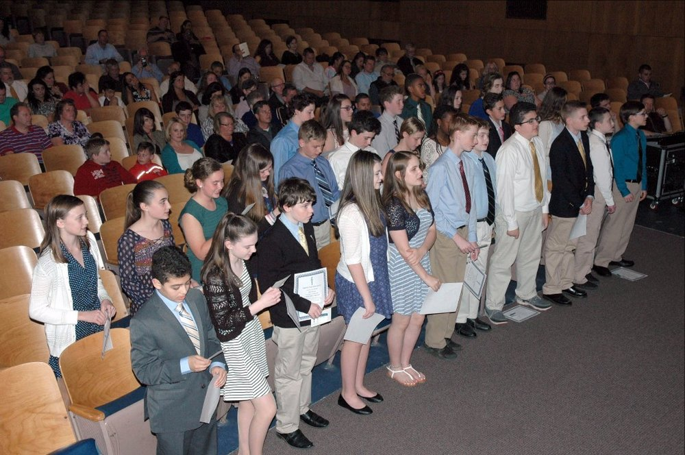 Congratulations:  The newest members of our National Junior Honor Society hold their certificates at their induction ceremony on Thursday.