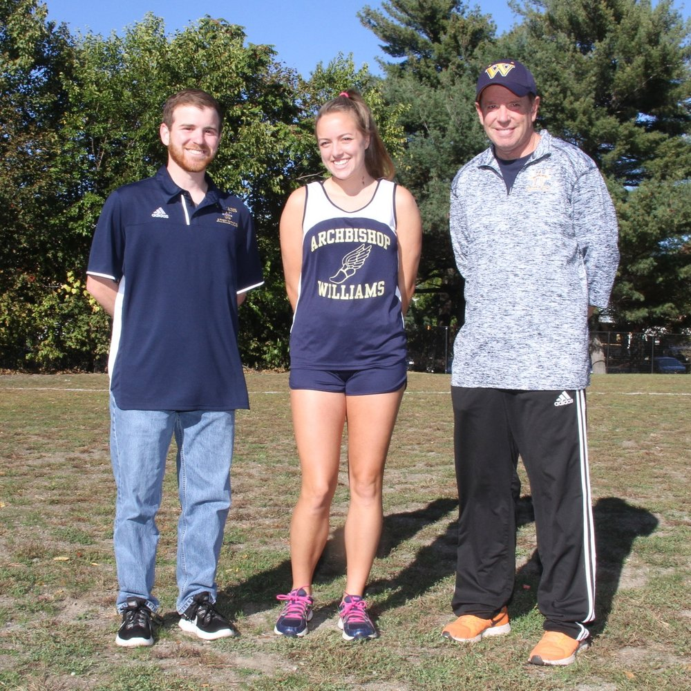 Shannon Kelley of Quincy with her four-year coach, Bryan Van Dorpe, right, and assistant coach James Leonard, left.