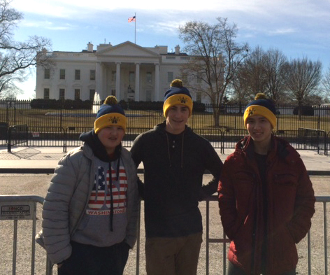 AT THE WHITE HOUSE:  From left, Noah Dembrowsky '21, Collin Driscoll '21, and Luan Nguyen '19, wear their AWHS hats with pride outside the White House,