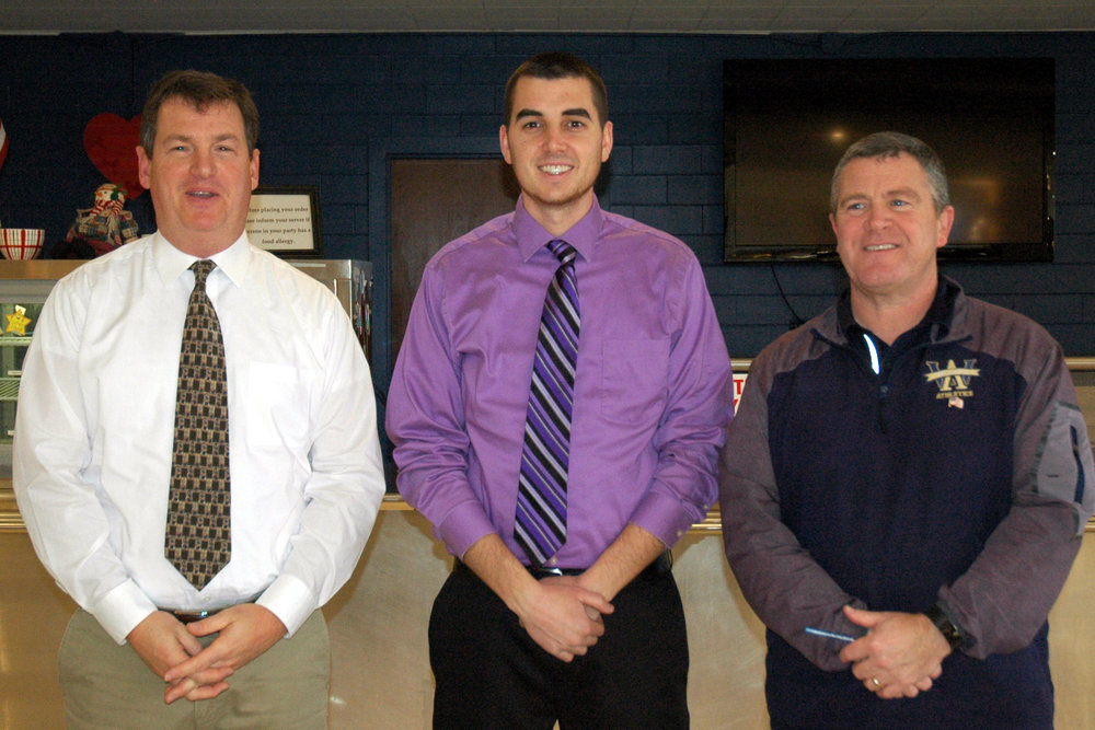 New Head Coach: Matt Marks '85, left, was named Head Coach of the Boys Lacrosse Team this week. With him are Assistant Coach Peter Curley, center, and Athletic Director Gordie McClay