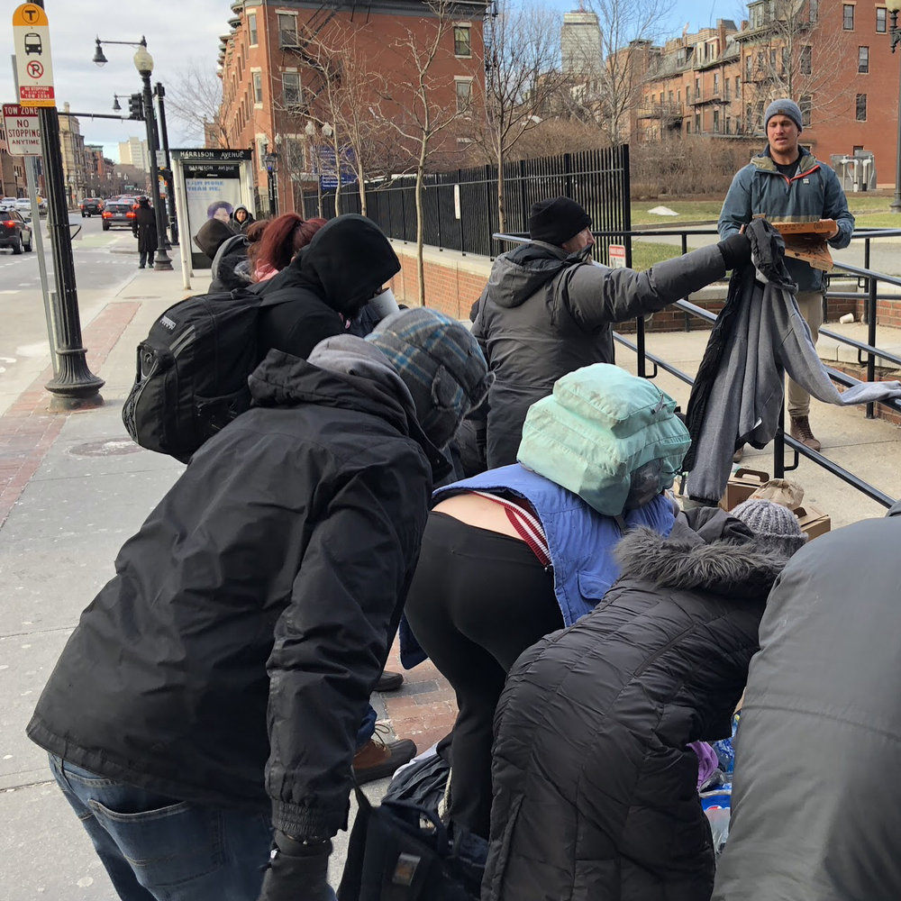 Ash Blell '14 and his friend Nick Bonasoro delivered coffee, donuts clothing and other items to homeless persons near the intersection of Mass. Avenue and Melnea Cass Boulevard in Boston.