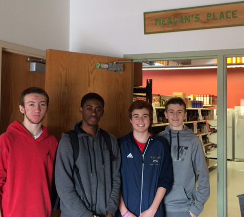 NEIGHBORHOOD CENTER: Students helped out at the Germantown Neighborhood Center food pantry. From left, John Marklis,   Marc-Andy Mexil, Matt Klier, Stephen Moran.