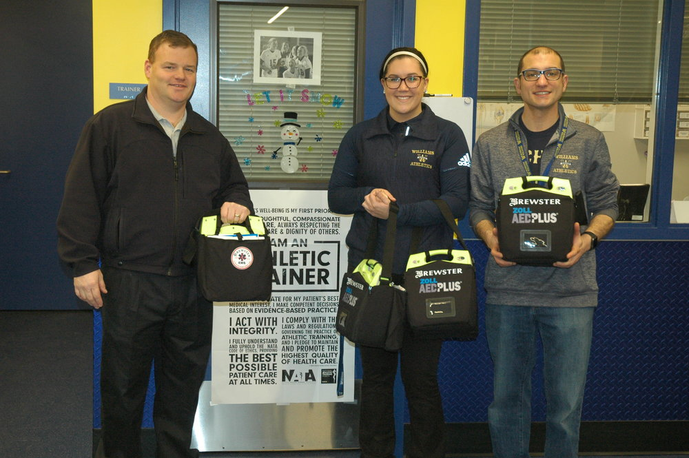 AED DONATION: George Brewster of Brewster Ambulance Services, left, donated four AED's to the sports program. With him are Athletic Trainer Stephanie Adukonis, a certified CPR/AED instructor, and Principal Dr. Michael Volonnino.