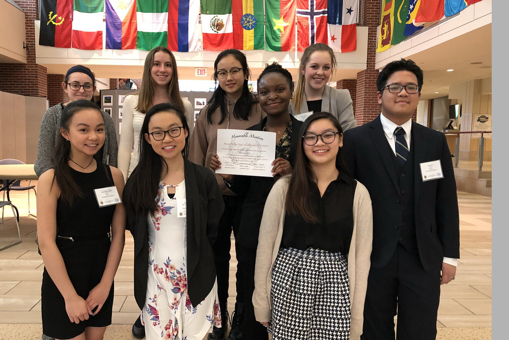 The Archbishop Williams High School chapter of Model United Nations participated in the Boston College High School 26th Annual Model UN Conference March 3. Chapter Vice president Imuetiyan Eweka (Randolph), center, holds an Honorable Mention award for Outstanding Leadership and Achievement, her second this year. Front row, from left: freshman Christina Zhao (Quincy), junior and Secretary/Treasurer Silvianna Zhao (Quincy), and junior Pauline Tran (Randolph). Second row: juniors Haley Donaghey (Bridgewater), Erica MacSweeney (Canton), President Han Viola Xu  (Braintree), sophomore Eweka (Randolph), juniors Joanna Gordon (Braintree) and Huy Dan Tran (Stoughton).