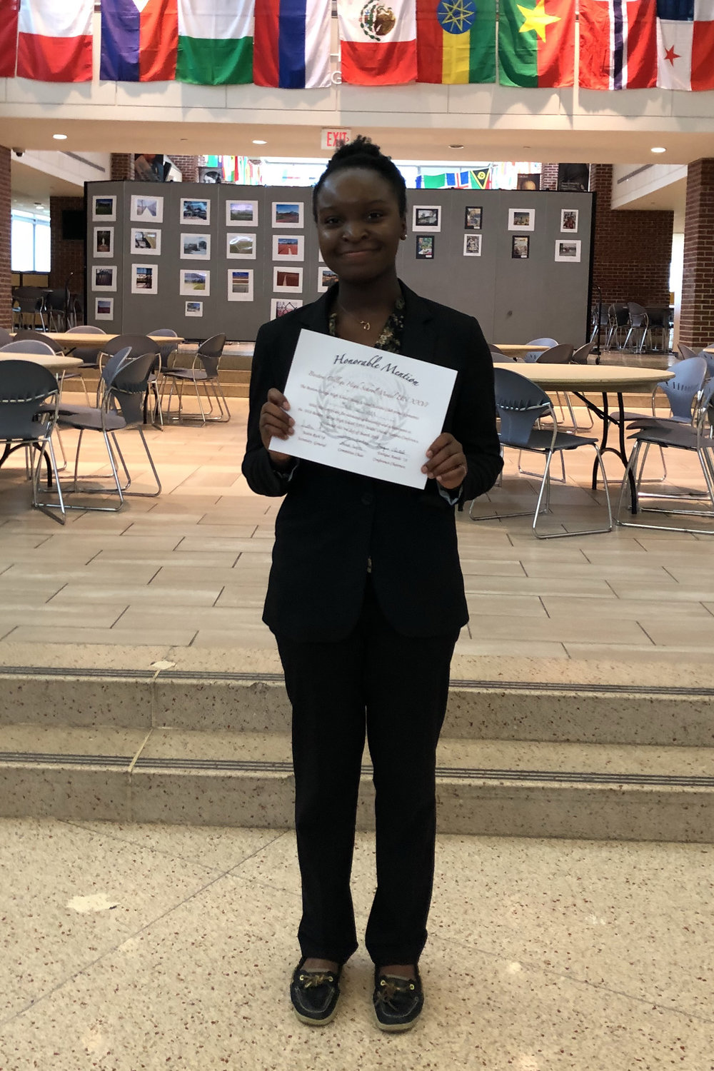 Model UN Chapter Vice President Imuetiyan Eweka displays her Honorable Mention award - her second this year - for Outstanding Leadership and Achievement. The award was presented at the Boston College High School 26th Annual Model UN Conference.  Her first award award was presented at the Catholic Memorial MUN Conference last November.