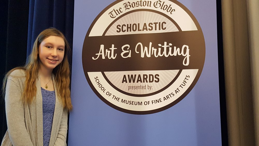 "Vanessa Lorusso was honored this year with two regional awards by the Mass. Scholastic Art and Writing Awards program for her short stories. At a ceremony at Tufts University on March 17, she received a Gold Key for ""Wilson and His Snowman."" She has also been awarded an Honorable Mention for ""Home Away in the Stars."" The program was sponsored by the School of the Museum of Fine Arts at Tufts University and the Boston Globe."