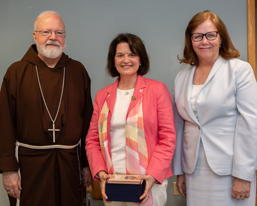 Beverly Ekstrom '71, center, a 31 year veteran of the Foreign Language Department, which she chairs, was presented with the first annual Archdiocese of Boston Excellence in Education Award by Cardinal Sean O'Malley and Kathy Mears, the Superintendent of the Archdiocese of Boston Catholic Schools.