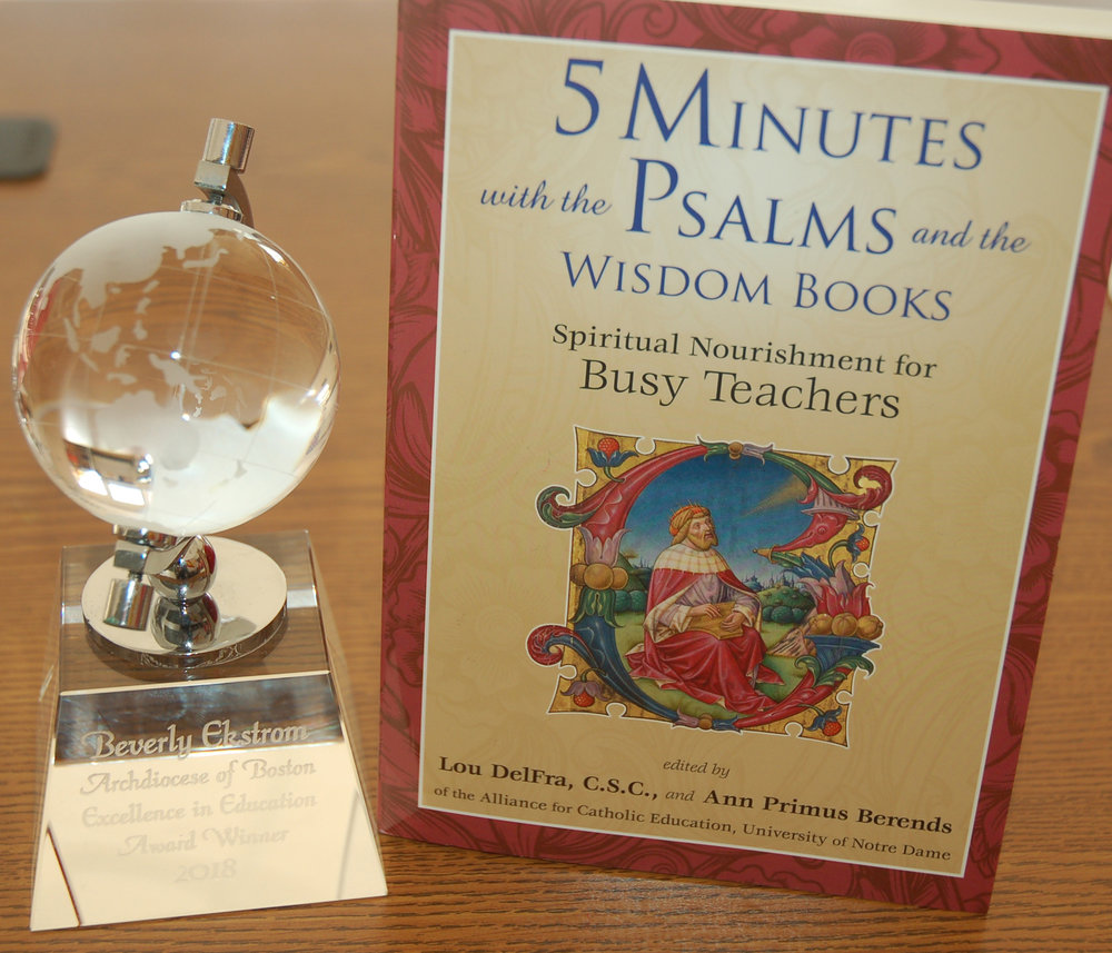"As an ""Archdiocese of Boston Excellence in Education Award Winner 2018,"" Beverly Ekstrom '71 was presented with a glass globe of the world with her name and award etched on the base; the book,""Five Minutes with the Psalms and the Wisdom Books;"" and $1,500 during a luncheon with Cardinal Sean O'Malley and Kathy Mears, Superintendent of the Archdiocese of Boston Catholic Schools."