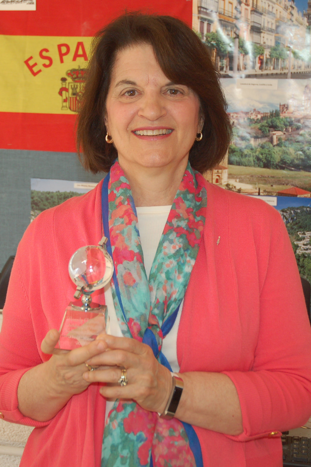 Beverly holding award.jpg