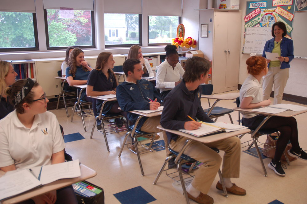 Beverly Ekstrom '71, doing what she loves best - teaching Spanish - with her Spanish 2 Honors class. Mrs. Ekstrom was chosen by the Archdiocese of Boston for the inaugural Excellence in Education Award 2018.