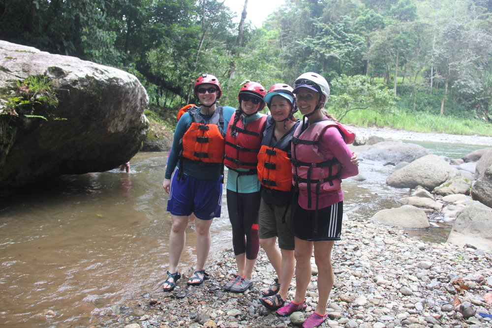 Ms. Churchill, second from left, enjoys a break with her rafting partners before continuing their journey.