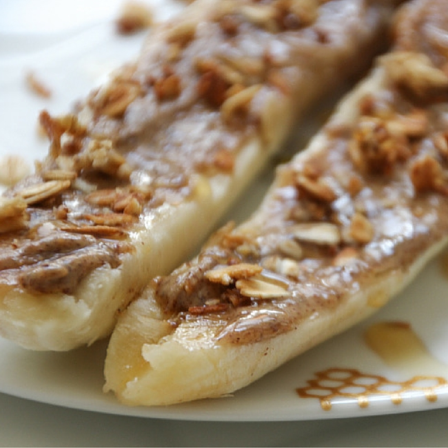 Easy breakfast Grananas made with banana, nut butter, granola and drizzled honey!