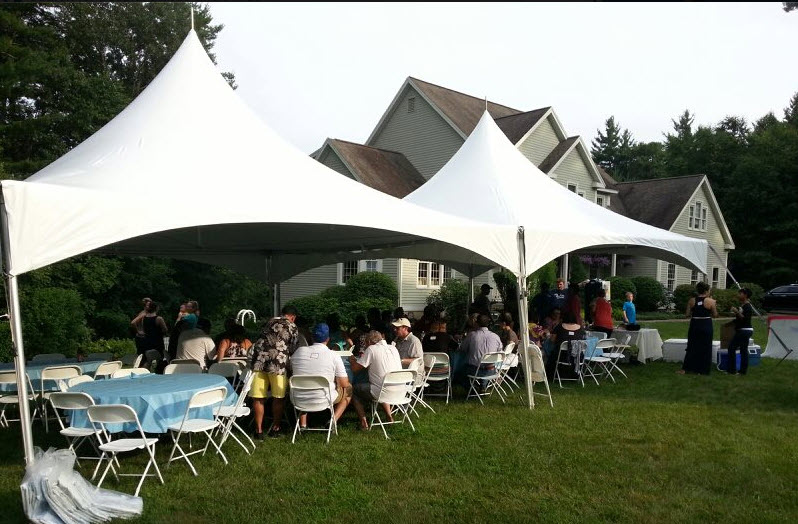 Our 80 person package. A 20x40 tent, 8 round tables, 80 folding chairs, 4 long tables.